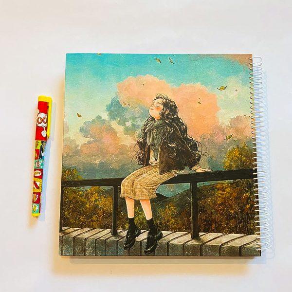 دفتر بی خط بزرگ دختر روی نرده